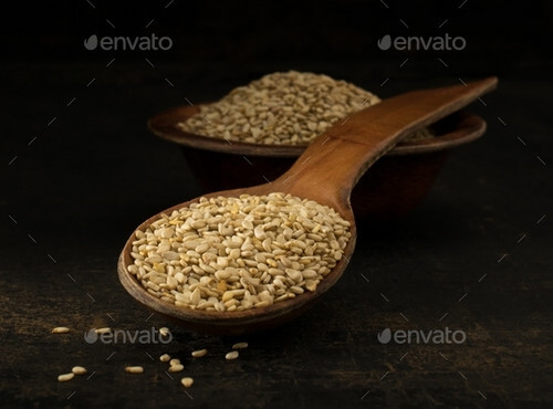 A wooden spoonful of sesame seeds